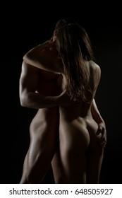 Gorgeous couple embracing nude studio portrait