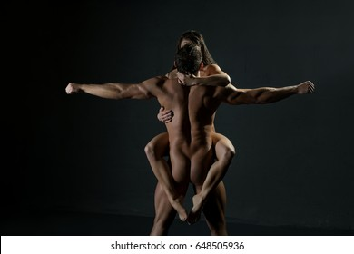 Gorgeous couple posing nude studio shot