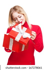Gorgeous cute young blond woman holding bright red present box.