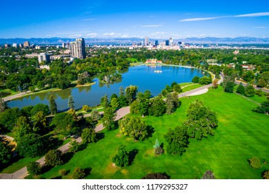 A gorgeous day in the park. City Park aerial drone view with Denver Colorado skyline background green space view high above the mile high city along the Rocky Mountain front range blue pond