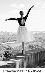 A gorgeous European young woman ballet dancer in city, inspiration for other people. Looks like princess have grace and body plastic dancing on outdoors