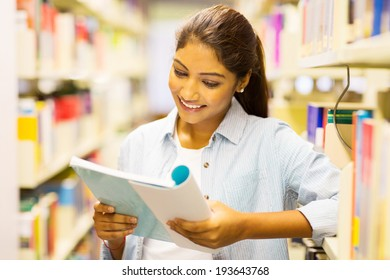 gorgeous female university student reading a book