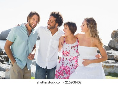 Gorgeous friends smiling at each other on a sunny day