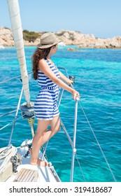 Gorgeous girl admires a magnificent turquoise lagoon, Budelli Island, Sardinia, Italy