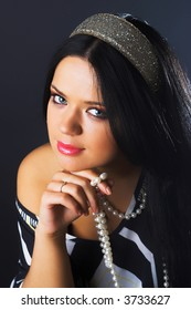 Gorgeous girl with pearl necklace