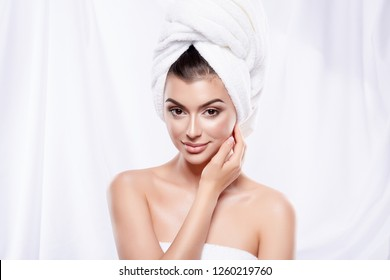 Gorgeous girl wearing white towel at white studio background, beauty photo concept, close up, SPA, health care concept.