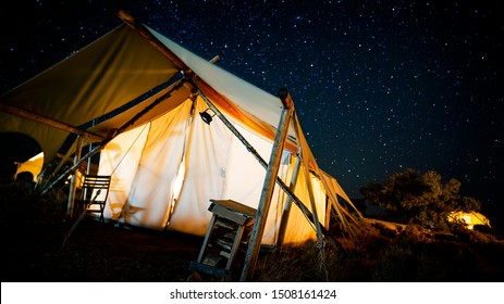 Gorgeous glamping canopy tent at night under the stars in Southern Utah near Moab