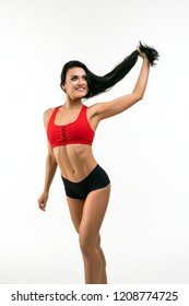 Gorgeous happy girl in sportswear isolated shot