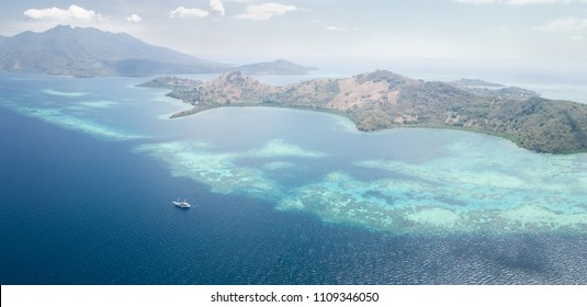 Gorgeous and healthy coral reefs grow around islands near Flores in Indonesia. This beautiful tropical region harbors amazing reefs and a wide array of marine life.