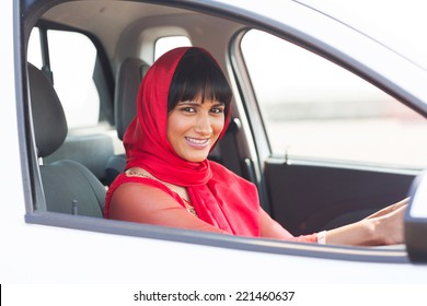 gorgeous indian woman driver inside a car