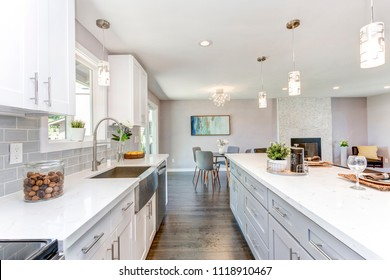 Gorgeous kitchen with open concept floorplan, white cabinets and huge island.