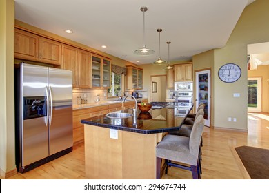 Gorgeous kitchen in perfect traditional home, with large island and light toned hardwood floor.