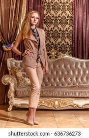 Gorgeous lady in the baroque styled room