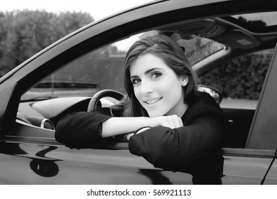 Gorgeous lady portrait in car black and white