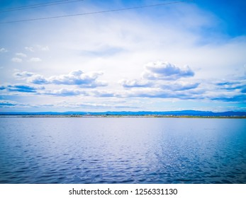 The gorgeous landscape of the natural park La Albufera in Valencia, Spain, Europe. The photo features the fresh water of the lagoon reflecting the sky. It was taken close to the El Palmar town.