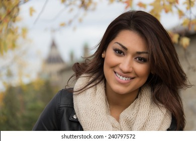 Gorgeous Latino woman outdoors during autumn