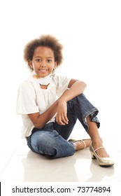 A gorgeous little 7yr old African girl in the studio.  White background.