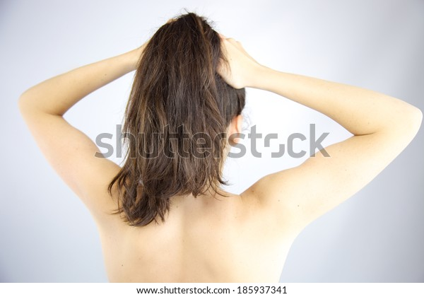 Gorgeous long hair held in ponytail with naked back