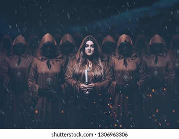 gorgeous menacing femme fatale in the image of a mysterious priestess standing in a group, masks on their faces and brown cloaks and hoods, a dark magic secret photo with art addition