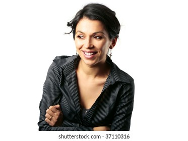 Gorgeous middle age Latin American woman looking with admiration at something next to her isolated on white