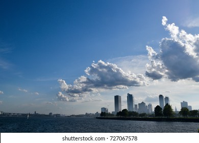 Gorgeous Milwaukee lakefront with clouds rolling over the city onto the lake.
