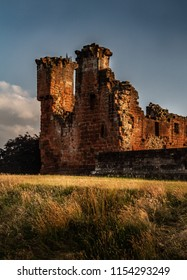 Gorgeous moody shot of the corner portion and surrounding wall of Penrith Castle at sunset in Cumbria, England UK.