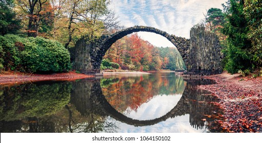 Gorgeous morning pznorama of Azalea and Rhododendron Park Kromlau, Germany, Europe. Incredible autumn view of Rakotz Bridge (Rakotzbrucke, Devil's Bridge). Instagram filter toned.