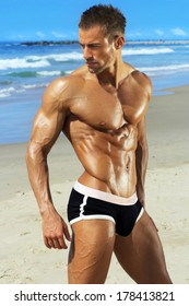 Gorgeous muscular young man at beach
