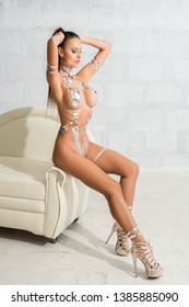 Gorgeous nude woman with silver tape bodyart