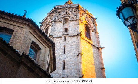 A gorgeous photo of the Micalet tower, also known as Miguelete tower, which is popular touristic Valencian gothic style tower bell that is part of the catholic cathedral of Valencia, in Spain, Europe