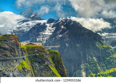 Gorgeous picturesque location, First named mountain station with Cliff Walk and Schreckhorn peak in background, Grindelwald, Bernese Oberland, Switzerland, Europe