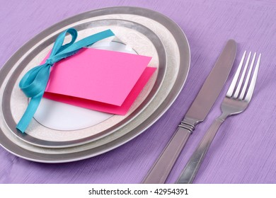 Gorgeous pink card on festive plate on violet