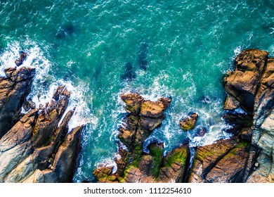 Gorgeous planet , Dramatic drone angle straight down view above Tropical waves crashing along California coastline Rocky Sandy Beach along Monterrey Coast near Big Sur off Pacific coast Highway
