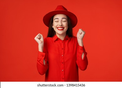 gorgeous pretty woman in red shirt with make up on face model luxury red isolated background