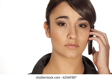 Gorgeous professional woman answering her mobile phone on white background.