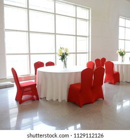 gorgeous red chairs and white table setting for fine dining.