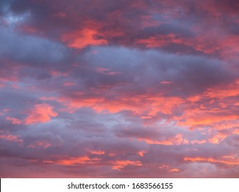 Gorgeous red and orange sunset clouds against a blue sky.