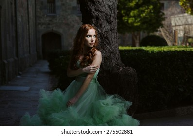 Gorgeous Redhead Girl In Cloudy Mint Dress In Medieval Castle