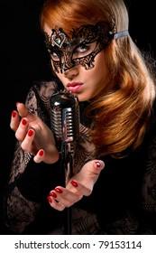 Gorgeous redhead woman singing