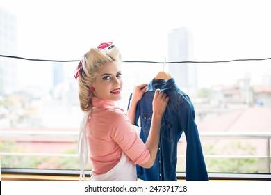 Gorgeous retro housewife hanging denim jacket