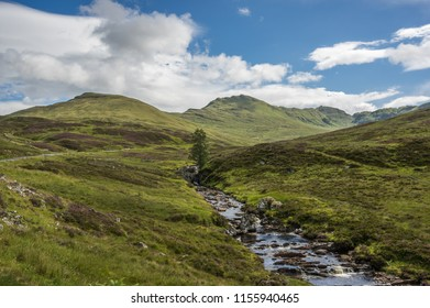 Gorgeous scenery of a river running through Ben Lawers, Scotland