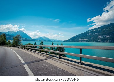 gorgeous scenery view of lakeside road in the Alpines with beautiful lake in Switzerland