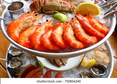 Gorgeous seafood platter with prawns, lobsters, scallops, oysters and more.
