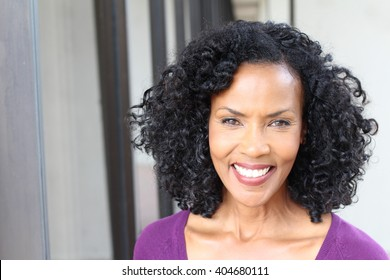 Gorgeous senior African American woman wearing glasses with copy space