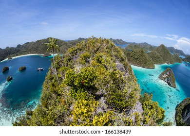 A gorgeous set of limestone islands, covered by tropical vegetation, make up an area known as Wayag in Raja Ampat, Indonesia. This region is known for its high marine biological diversity.