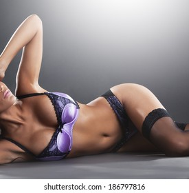 Gorgeous sexy young woman in lingerie in studio