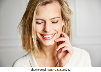 Gorgeous smiling woman with eyes closed