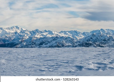 Gorgeous snowy mountains and mantle of snow in North Italy