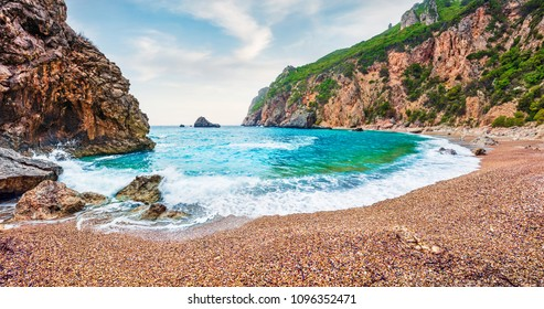 Gorgeous spring view of Gyali beach. Panoramic morning seascape of Ionian Sea. Fantastic outdoor scene of Corfu island, Greece, Europe. Beauty of nature concept background.