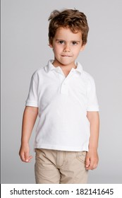 Gorgeous studio portrait of handsome toddler boy.
